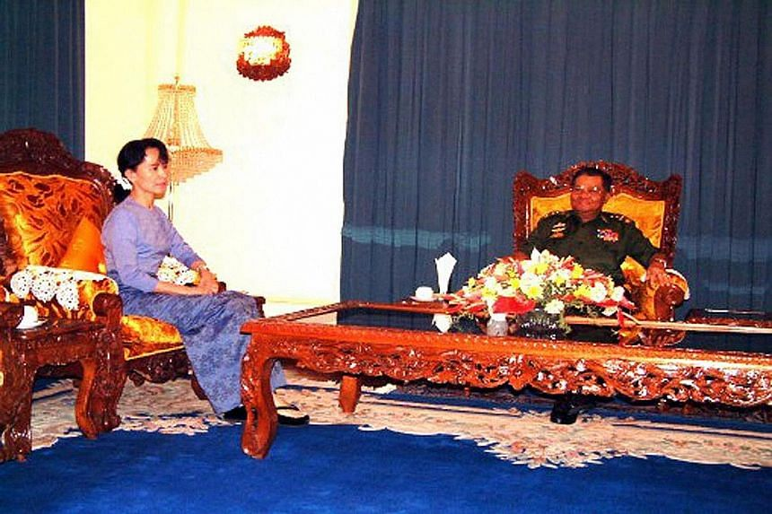 An undated photograph splashed across the front page of the state-run New Light of Myanmar showing democracy leader Aung San Suu Kyi with General Than Shwe. The last time she met the general was in 2003.