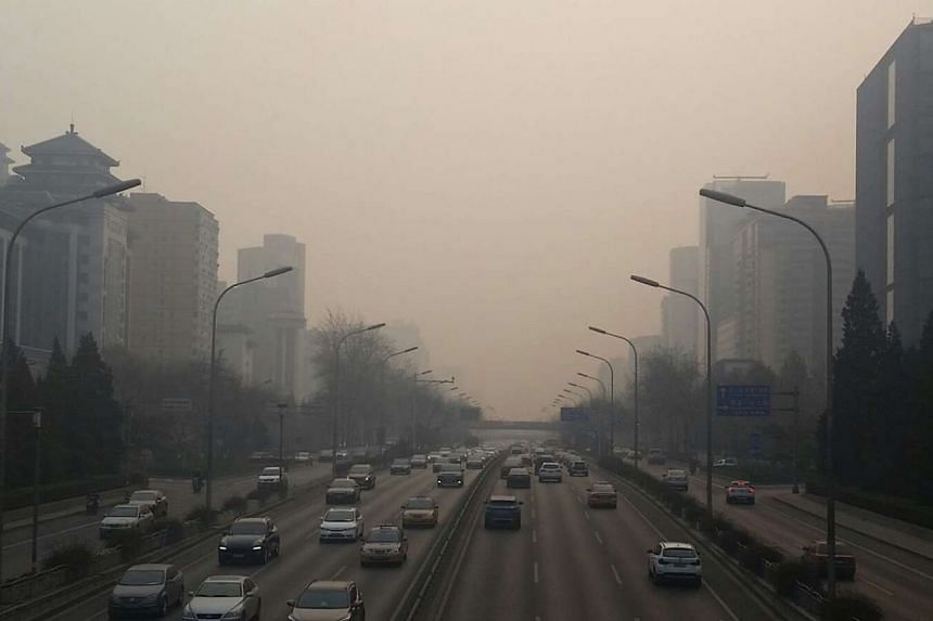 Smog shrouds a road in Beijing on Dec 7, 2015.