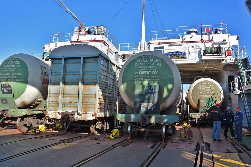 Turkish cargo train carriages sit on a transport ship after they were sent back at the Russian border.