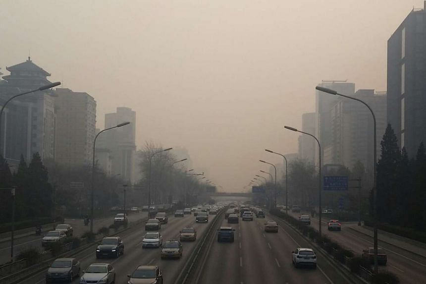 Acrid-smelling smog rolled back into Beijing, shrouding the city of 20 million people in a gray haze.