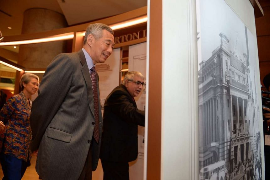 PM Lee Hsien Loong touring the Fullerton Stories Exhibition at Fullerton Hotel on Dec 7, 2015.