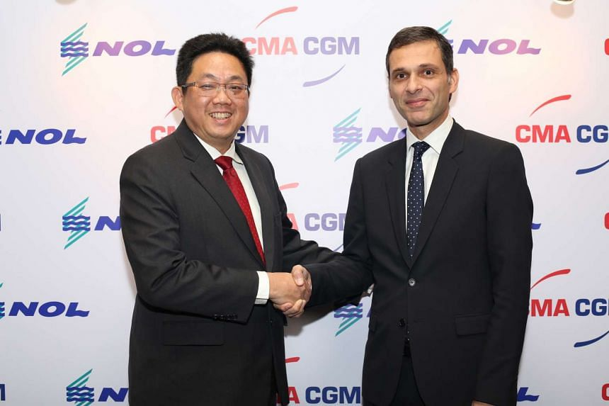Mr Ng Yat Chung (left), chief executive of Neptune Orient Lines (NOL) and Mr Rodolphe Saadé, vice-chairman of CMA CGM shake hands. CMA CGM is buying NOL. PHOTO: CMA CGM, NOL
