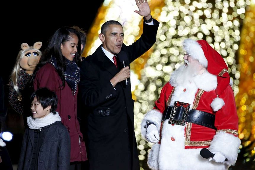 US President Barack Obama at the National Christmas Tree Lighting and Pageant of Peace ceremony near the White House in Washington.