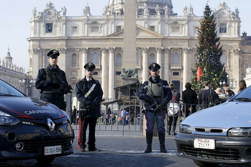 Security officers in front of the Vatican in Rome last Friday. A holy year, or Jubilee of Mercy, begins tomorrow and is expected to attract millions of visitors.