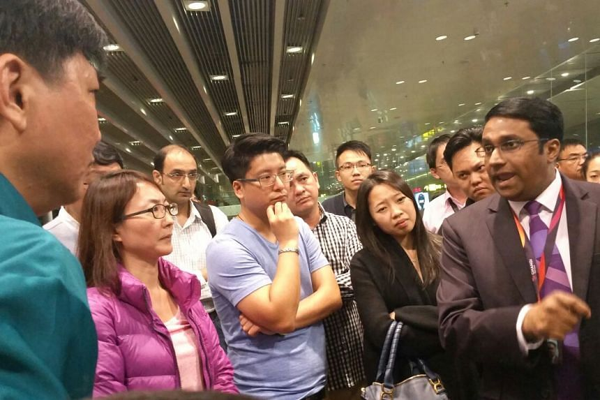 China Airlines and Changi Airport staff explaining the delay to passengers on Dec 7, 2015.