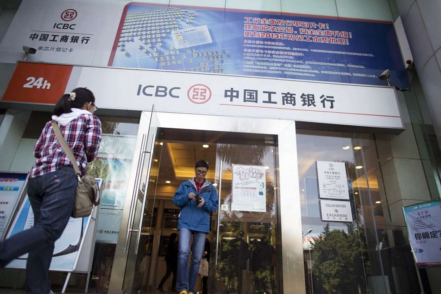 A man exits an Industrial and Commercial Bank of China Ltd (ICBC) branch in the central business district of Guangzhou, Guangdong province, China.
