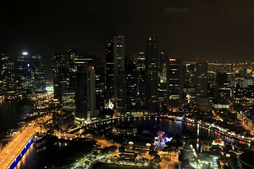 An aerial view of the Marina Bay skyline after the lights were turned off for the Earth Hour event on March 29, 2014. Earth Hour is a global campaign aimed at highlighting the importance of reducing carbon footprint.