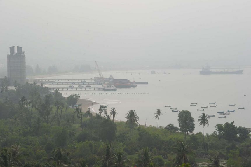 Thick haze shrouds a local port in Malahayati, in the city of Banda Aceh on Indonesia's Sumatra island on Sept 19, 2015. Southeast Asia has been enveloped in choking haze from agricultural fires in Indonesia over the past fortnight, prompting flight