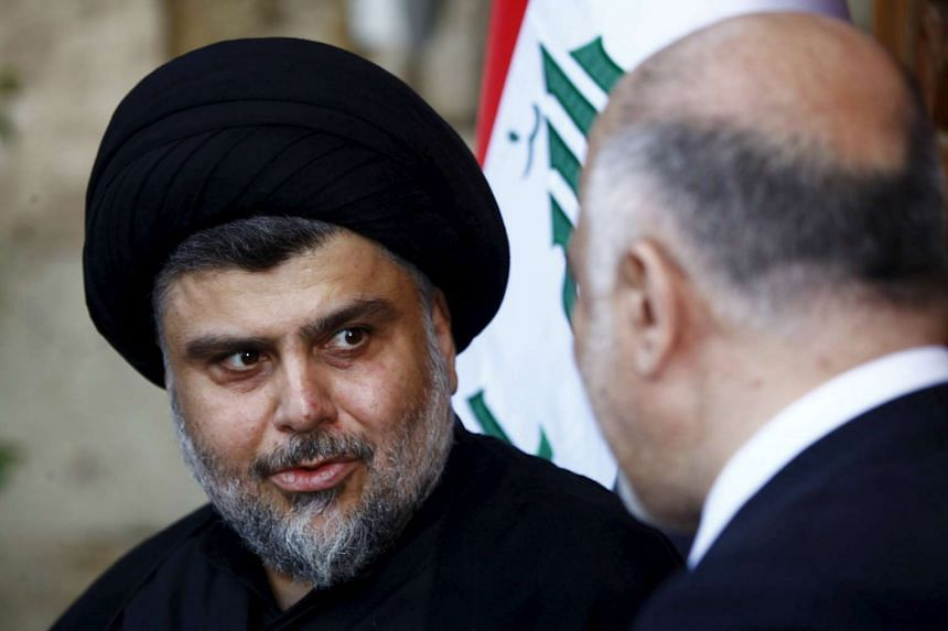 Iraqi Prime Minister Haider al-Abadi (right) and Iraqi Shi'ite radical leader Muqtada al-Sadr attend a joint news conference in the holy city of Najaf, Iraq, on Nov 7, 2015.