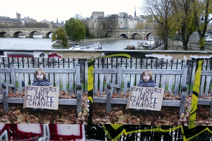 "Posters by street artist Denys are seen on the ""pont des Arts"" in support of the UN climate summit in Paris, France, on Nov 30, 2015."