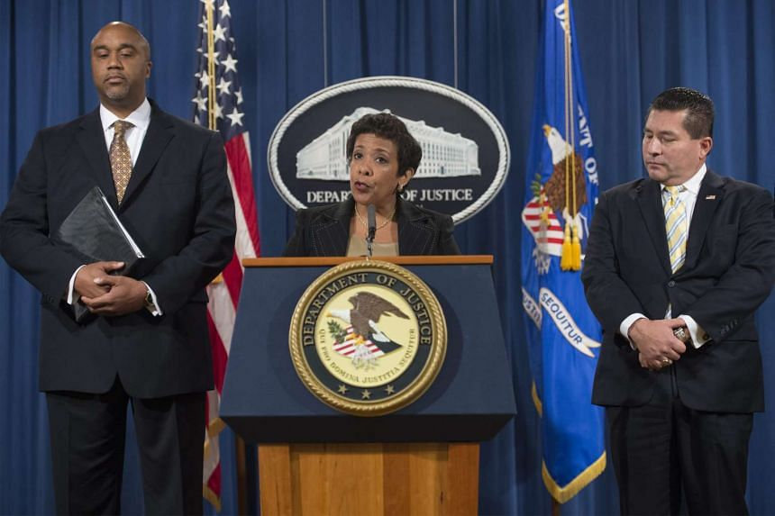 US Attorney General Loretta Lynch (centre) delivers remarks beside US Attorney for the Eastern District of New York Robert Capers (left) and FBI Assistant Director in charge of the New York Field Office Diego Rodriguez (R), during a press conference
