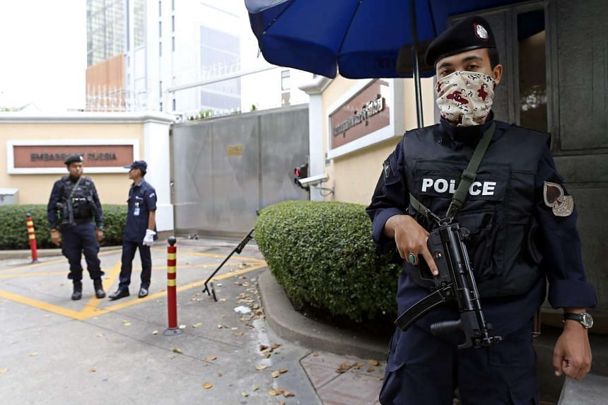 Thai armed security police officers guard the Embassy of Russia in Bangkok, Thailand.