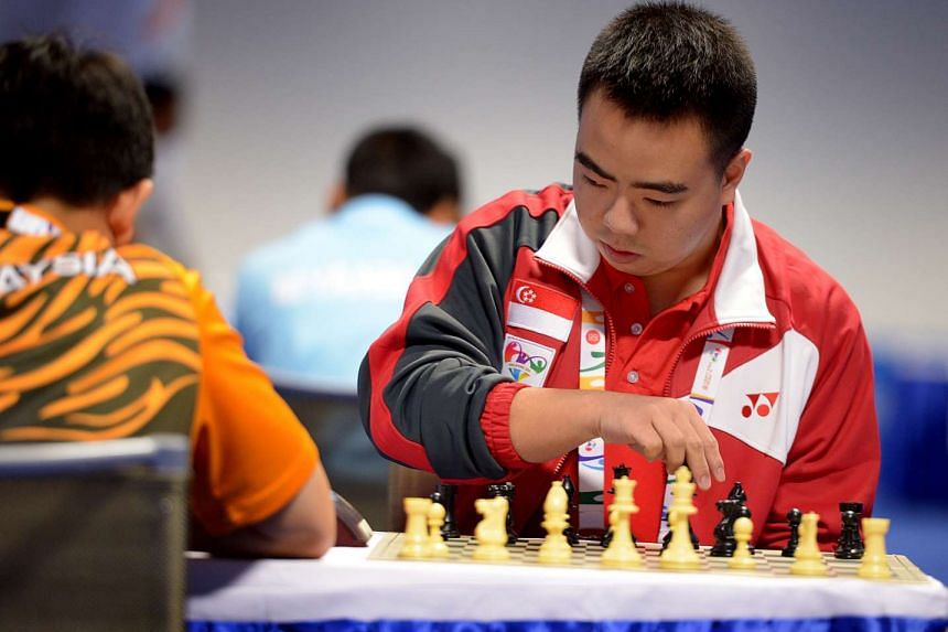 Singapore's Edwin Tan in action during a match.