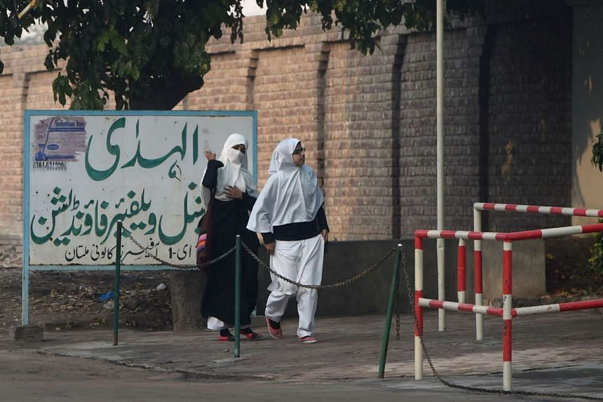 Pakistani students arrive at Al-Huda Institute, one of the most high-profile female seminaries (Islamic religious school), in Multan on Dec 7, 2015, where female US shooter Tashfeen Malik studied.
