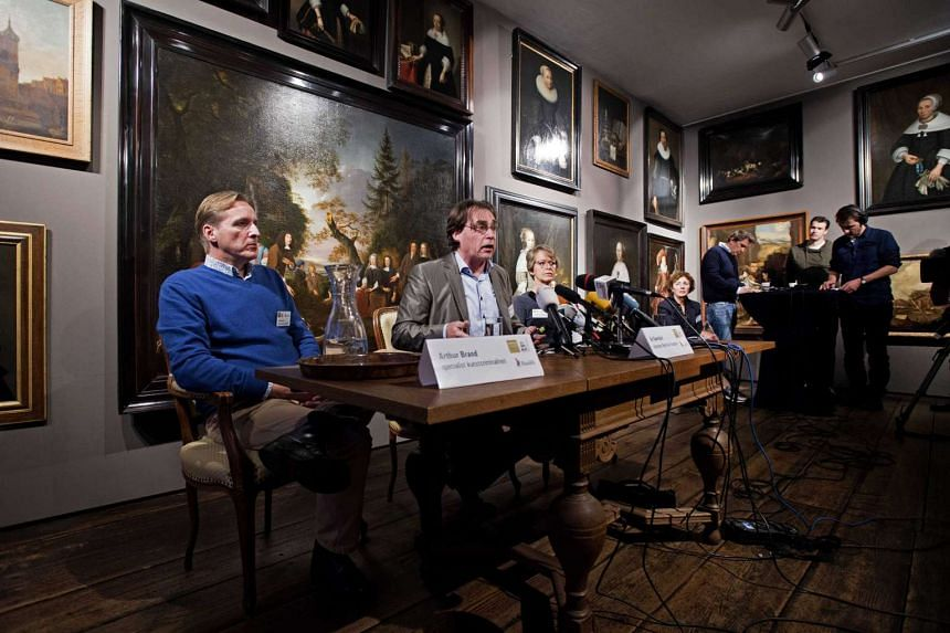 From left: Arthur Brand, a specialist in art crime, Ad Geerdink, director of the West Frisian Museum, and Yvonne van Mastrigt, mayor of Hoorn attend a press conference about the 2005 stolen art from the museum in Hoorn, The Netherlands, on Dec 7, 201