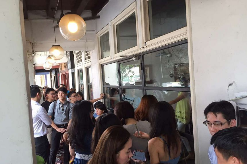The queue outside Strangers' Reunion cafe at noon on Tuesday, Dec 8, 2015.