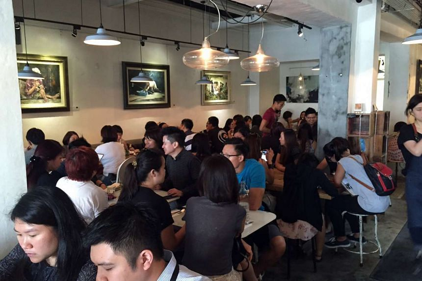 Tables inside Strangers' Reunion cafe were full as of 12.45pm on Tuesday, Dec 8, 2015.