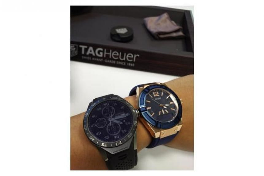 A Tag Connected watch (left) and a Guess Connect watch.