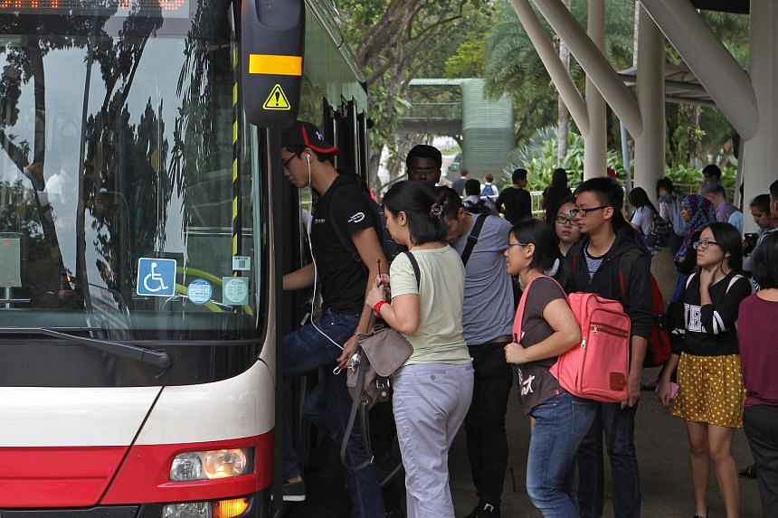 Young adults boarding a bus along Clementi Road.