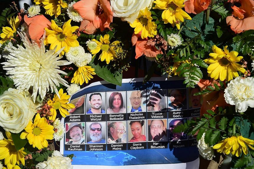 The deceased are remembered with their pictures placed within a wreath at a makeshift shrine near the scene of the shootings in San Bernardino, California.