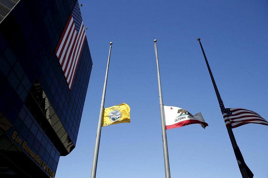 Flags fly at half-staff outside San Bernardino City Hall following the shootings.