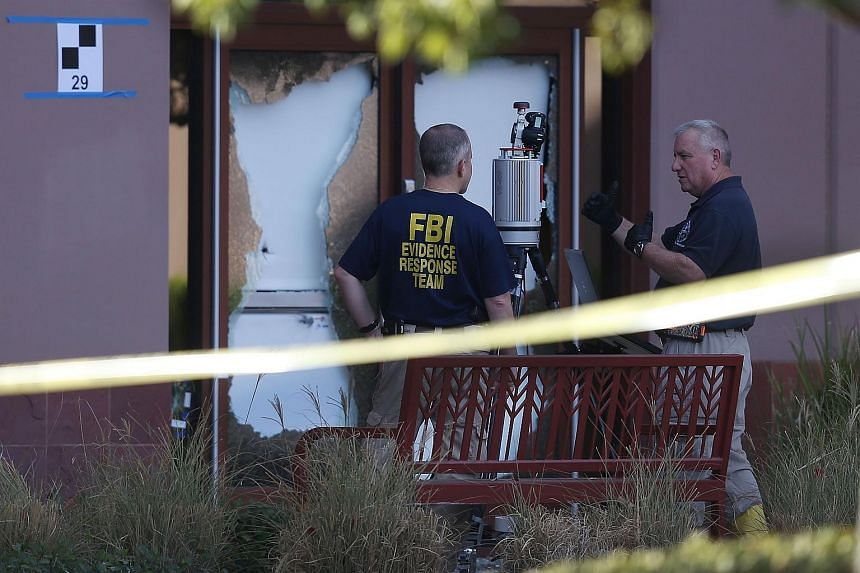 FBI agents investigate the scene in the building at the Inland Regional Center were 14 people were killed.