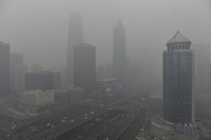 The Central Business District area in Beijing shrouded in heavy smog. The city has issued its first ever red alert for air pollution.