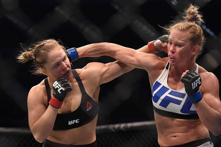 Ronda Rousey (left) and Holly Holm fighting during their UFC 193 bout at the Etihad Stadium in Melbourne, Australia, on Nov 15, 2015.