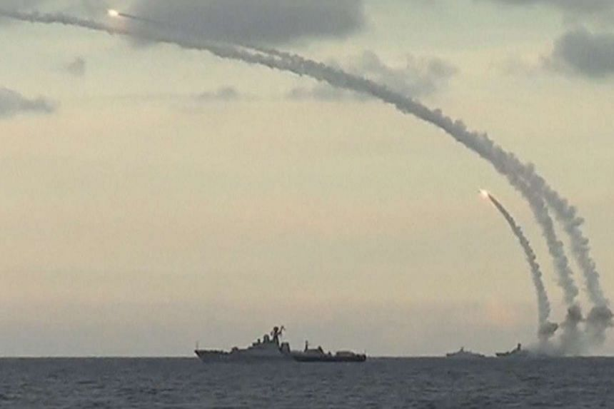 Russian navy ships launching cruise missiles at targets in Syria from the Caspian Sea, in a video released on Nov 20, 2015.