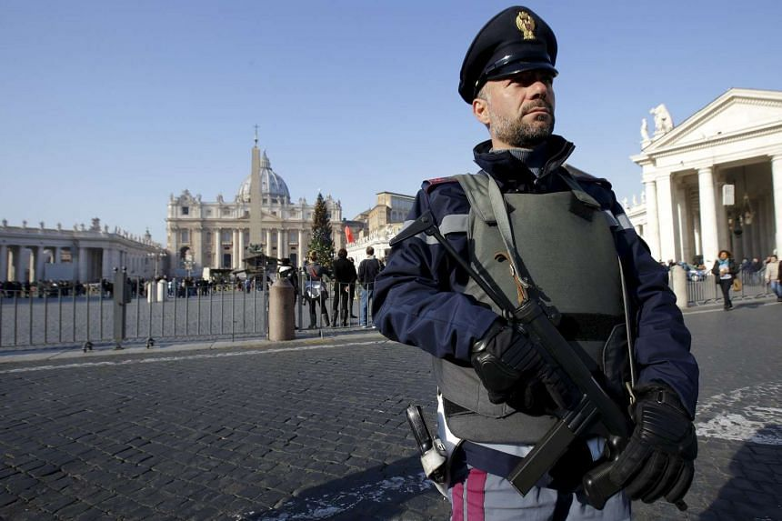 A policeman patrols in front of the Vatican in Rome on Dec 4, 2015.