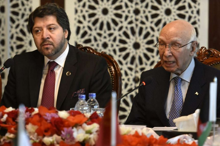 Pakistan's National Security Advisor Sartaj Aziz (right) and Afghan Deputy Foreign Minister Khalil Hekmat Karzai talk during the conference.