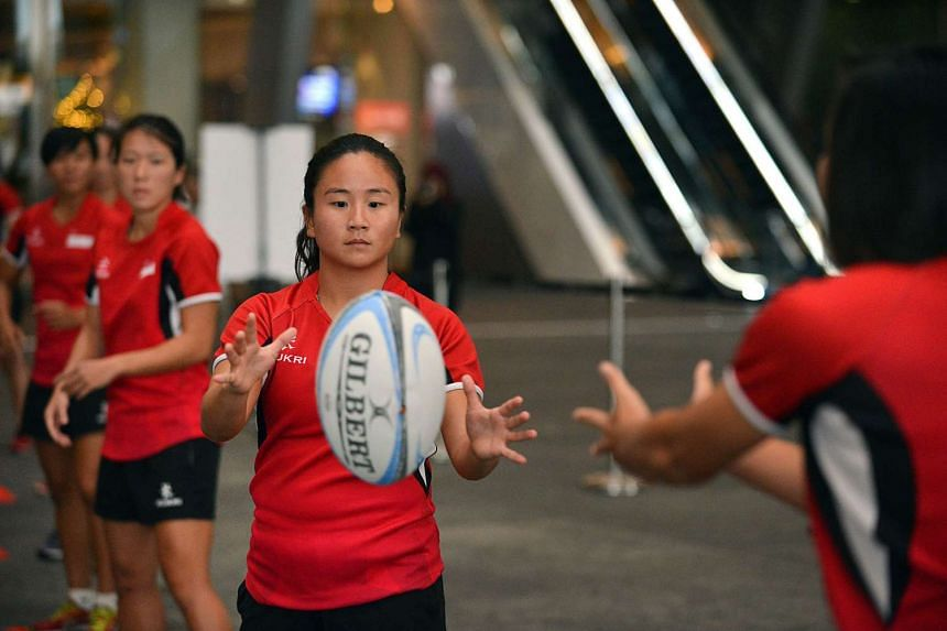 """Players from Singapore Rugby Union attempt to break the world record for the """"most rugby passes in an hour"""" on Dec 8, 2015."""