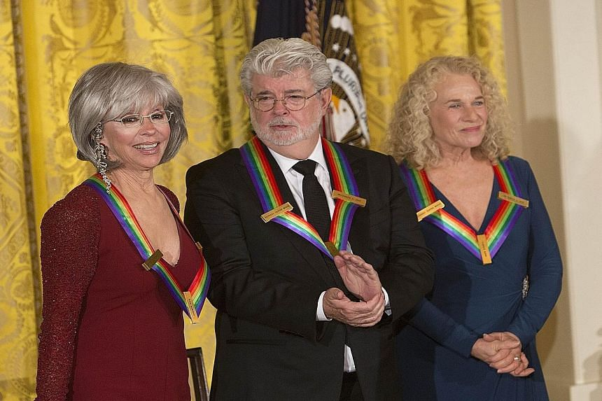 Kennedy Center Honors recipients: (From far left) actress and singer Rita Moreno, Star Wars creator George Lucas and singer- songwriter Carole King.