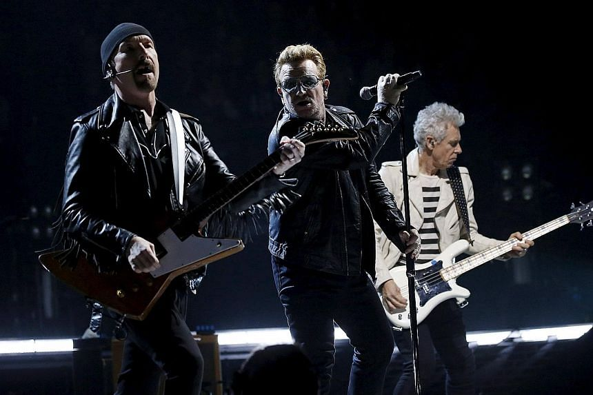 U2's (from far left, the Edge, Bono and Adam Clayton) concert on Sunday was the first large-scale cultural event in Paris since the Nov 13 terrorist attacks.