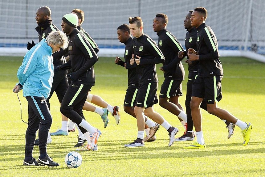 Manuel Pellegrini supervising a Manchester City training session yesterday. The Chilean manager will have influential midfielder Yaya Toure back in the squad for today's clash with Borussia Moenchengladbach.