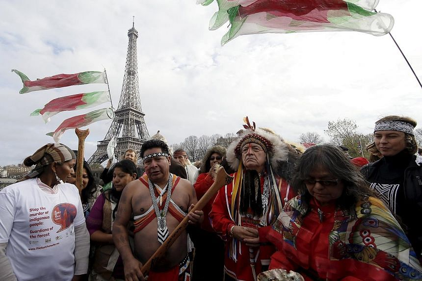 Indigenous leaders sailing on the Seine on Sunday near the Eiffel Tower during a gathering demanding what they call true climate solutions. Several developing countries want an accounting system that differentiates them from rich nations, saying they