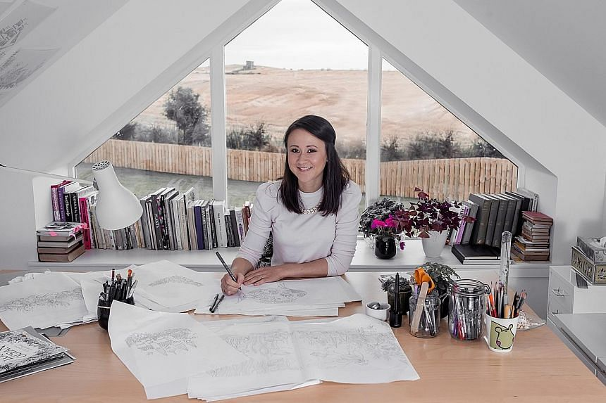 Illustrator Johanna Basford working at her home studio in Aberdeen, Scotland (left). Her latest book features her signature intricate drawings (below centre) of amazing detail that need fine-tipped pencils to colour them in.