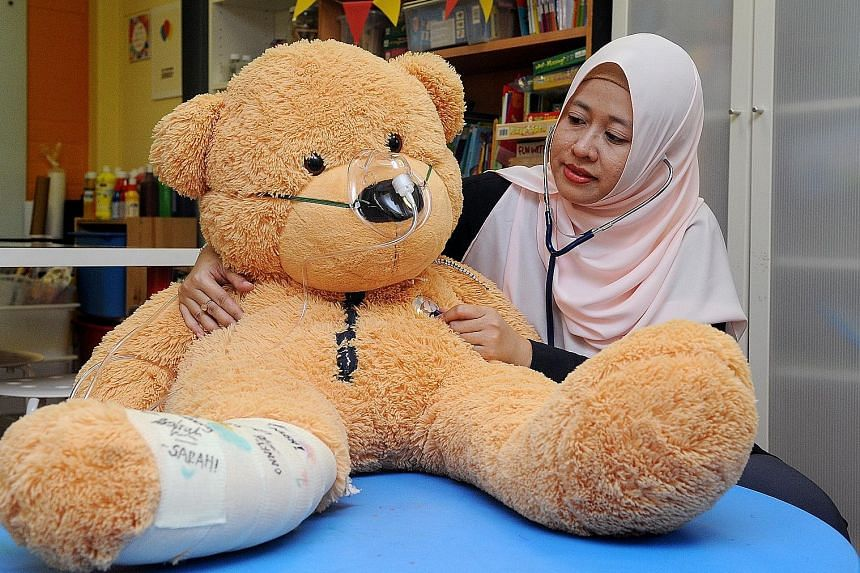 National University Hospital senior child life specialist Fadzilah Kamsin, 35, focuses on the psycho-social needs of children who require medical treatment.