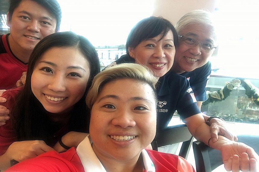 Theresa Goh (front) and family at Trung Nguyen Coffee cafe at Marina Bay Sands yesterday. From left are brother-in-law Kenny Han, sister Marisa, mother Rose and father Bernard.