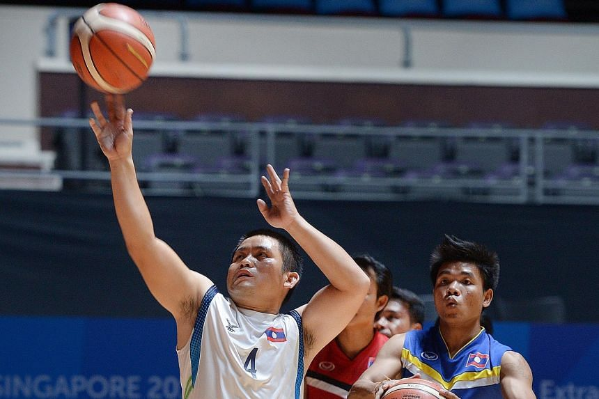 Chanthavong Vingthong (left), captain of the Laos wheelchair basketball team, used his financial knowledge to fund their trip to the Asean Para Games.