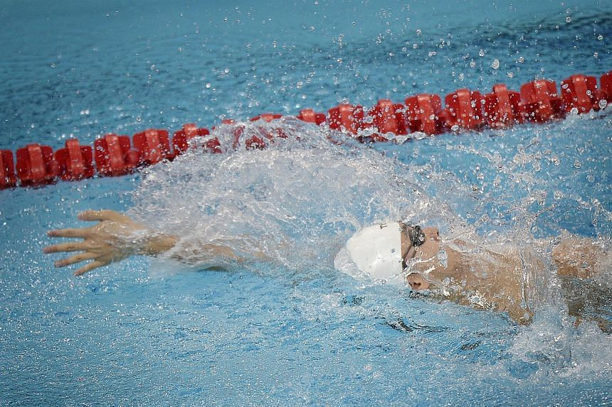 Toh Wei Soong on his way to victory in yesterday's 100m backstroke S8 timed final. It was the debutant's fourth gold medal of these Games, putting him one behind Paralympian Theresa Goh and Benson Tan.