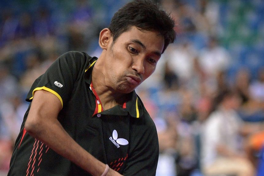 David Jacobs playing a shot during the current Asean Para Games in Singapore. The Indonesian has already won two golds and is the favourite to land the singles title too tonight.