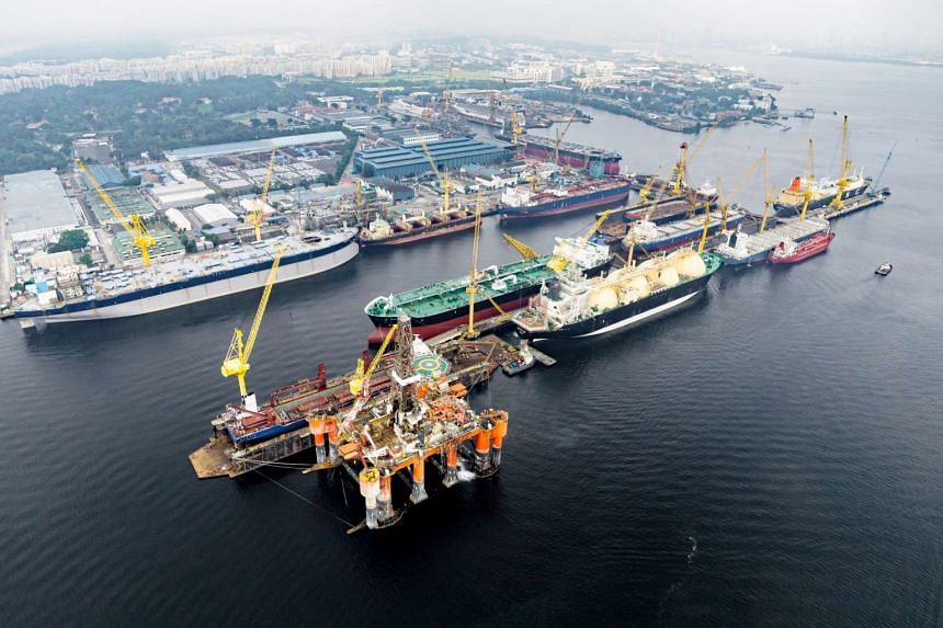 An aerial view of a concurrent repair of two LNG vessels at the Sembcorp Marine Admiralty Yard.