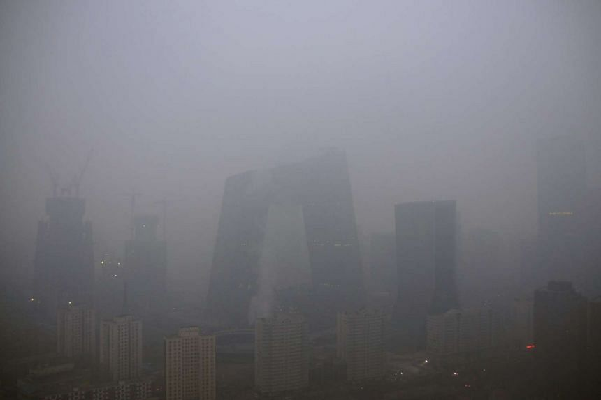 The China Central Television (CCTV) building and the Central Business District (CBD) area shrouded in heavy smog  in Beijing on Dec 8, 2015.