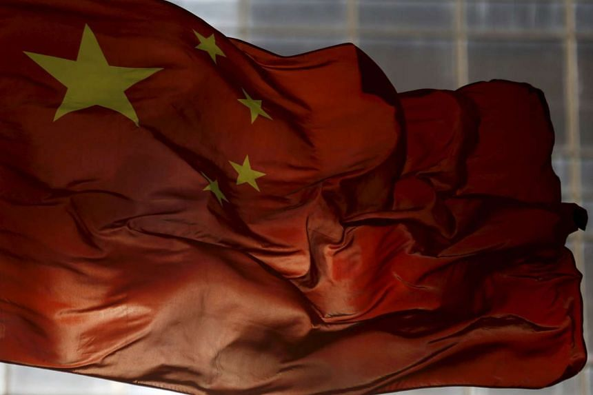 China's national flag flutters in Beijing on Oct 29, 2015.