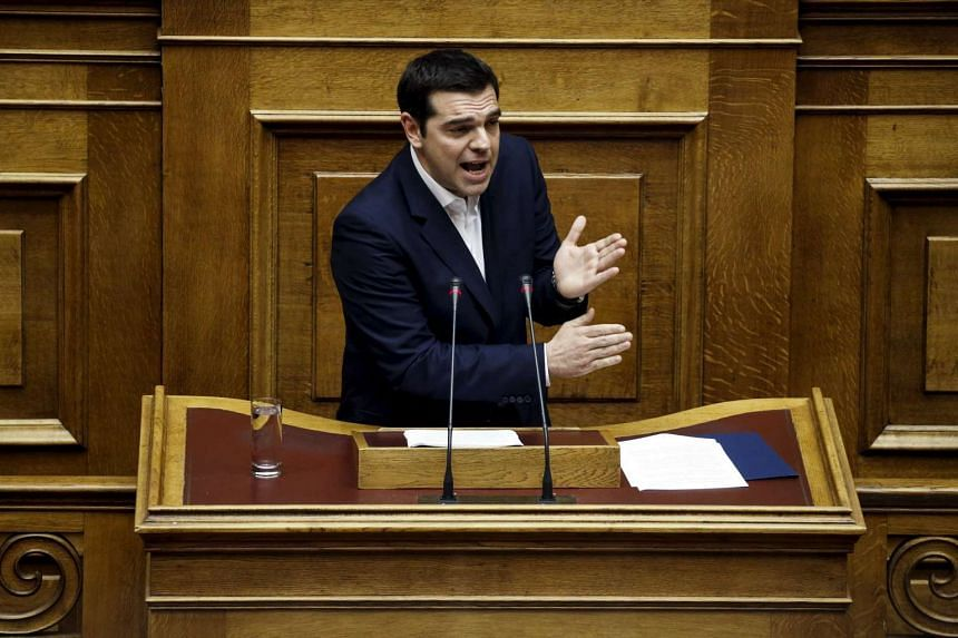 Greek Prime Minister Alexis Tsipras addresses lawmakers during a parliamentary session before a Budget vote in Athens.