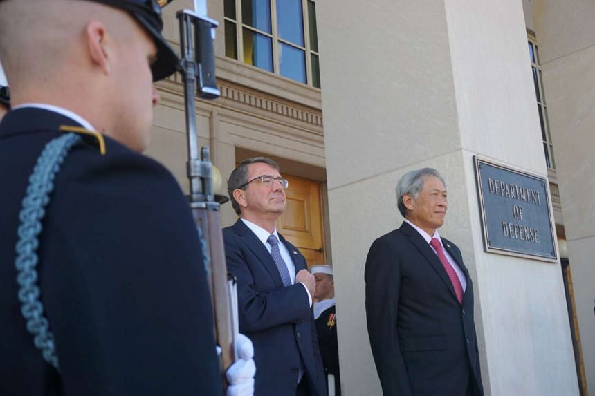 Singapore Defence Minister Ng Eng Hen (right) stands at attention with US Secretary of Defence Ash Carter (left) in Washington DC on Monday.