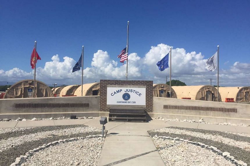 The US flag is seen at half staff on Sunday near the military courtroom in Guantanamo Bay, where five men accused of plotting the Sept 11, 2001 attacks are due in court this week.
