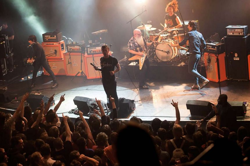 Eagles of Death Metal on stage at the Bataclan concert hall in Paris on Nov 13, 2015, moments before four men with assault rifles stormed in and massacred fans.