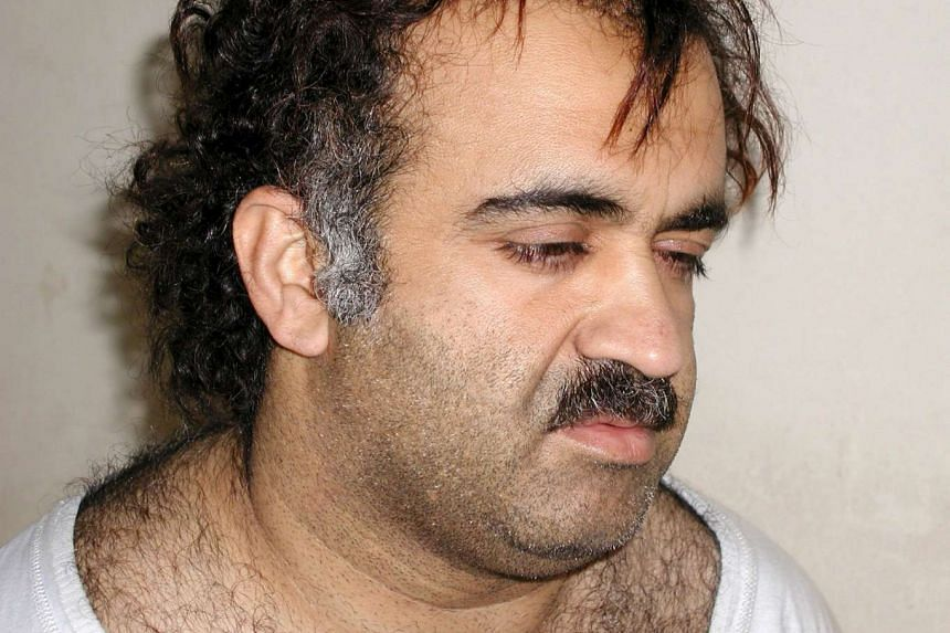 Khalid Sheikh Mohammed shown during his arrest in a March 1, 2003 photo.